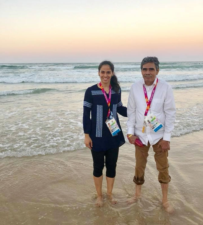 Saina Nehwal and her father Harvir Singh Nehwal wet their feet at Surfers Paradise Beach at Gold Coast