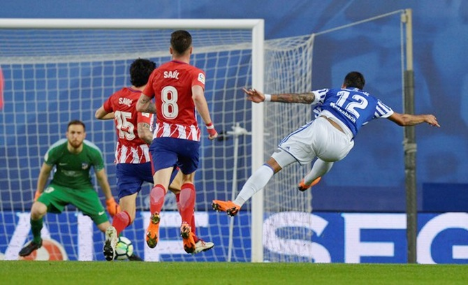 IMAGE  Real Sociedad s Willian Jose shoots at goal during Thursday s La  Liga match against Atletico Madrid. Photograph  Vincent West Reuters a512f4c4d8431