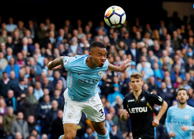 EPL: Man City power past Swansea; Arsenal win