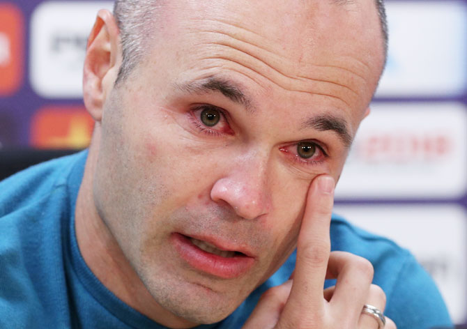 FC Barcelona's Andres Iniesta cries during a press conference annoucing his departure from the club