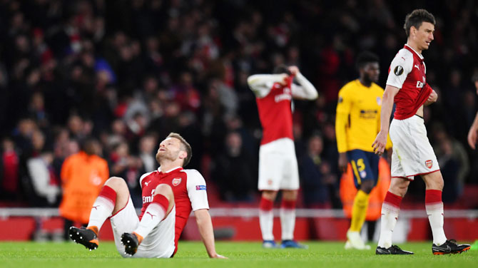 Arsenal's Shkodran Mustafi and Laurent Koscielny react after their Europa League Semi Final First Leg match against Atletico Madrid at Emirates Stadum on Thursday