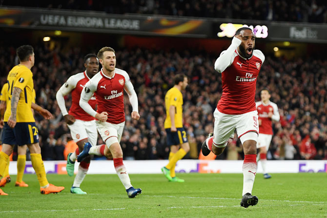 Arsenal's Alexandre Lacazette celebrates after scoring the opening goal against Atletico Madrid