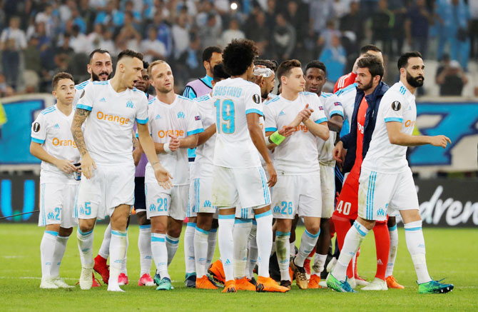 Marseille players celebrate after their Europa League Semi Final First Leg match against RB Salzburg at the Orange Velodrome, Marseille, France on Thursday