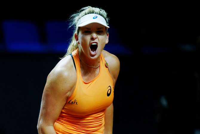 CoCo Vandeweghe of the US celebrates winning her semi-final match aginst France's Caroline Garcia at Stuttgart Tennis Grand Prix in Porsche-Arena, in Stuttgart on Saturday