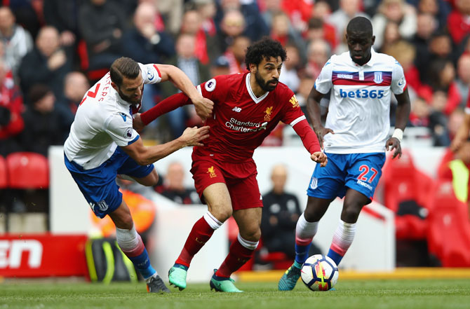 Liverpool's Mohamed Salah goes past Stoke City's Erik Pieters during their English Premier League match at Anfield in Liverpool on Saturday