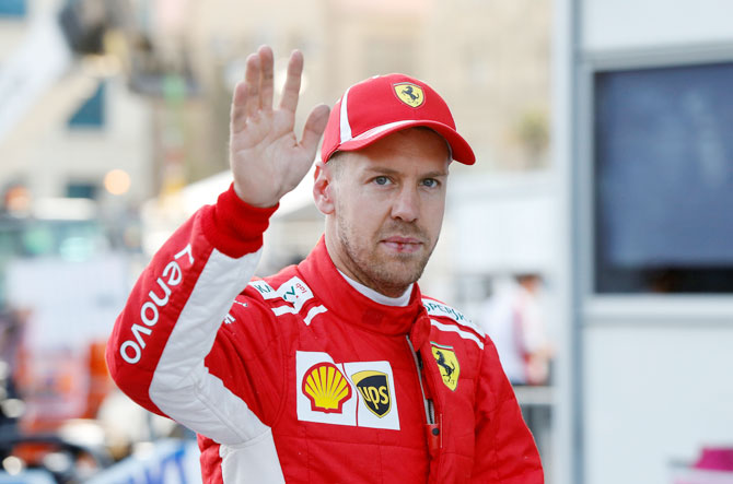 Ferrari's Sebastian Vettel celebrates the pole position