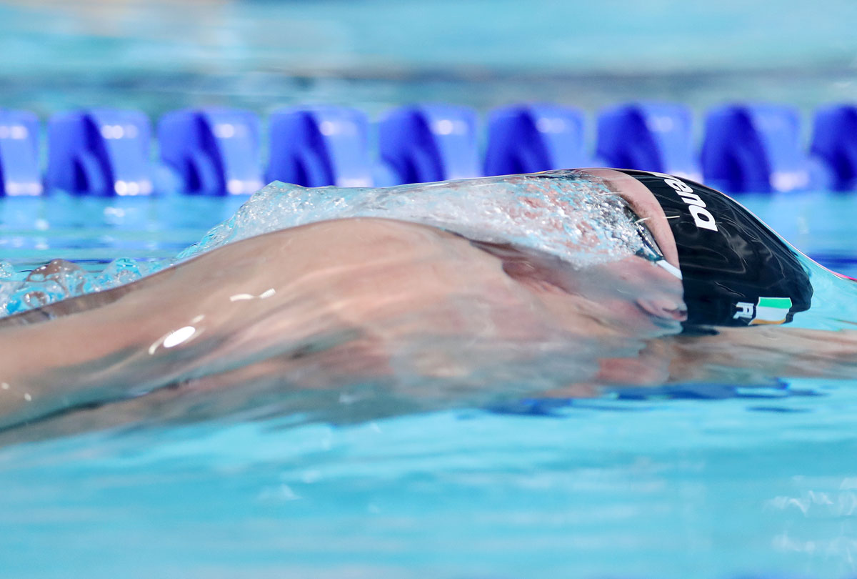Ireland's Shane Ryan competes in the Men's 100m Backstroke Semi-Final 1 at Tollcross International Swimming Centre in Glasgow on August 5