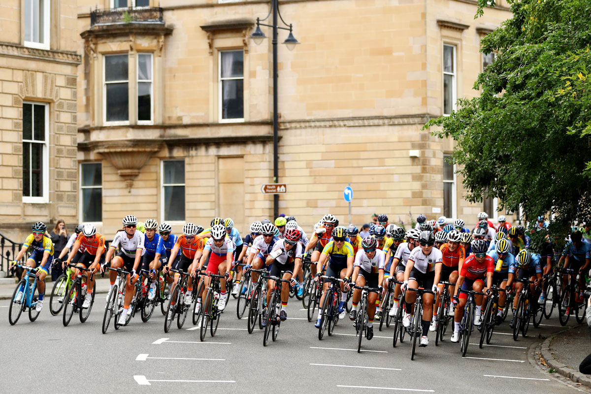 A general view as the peloton of women cyclists pass during a road race in Glasgow on August 5