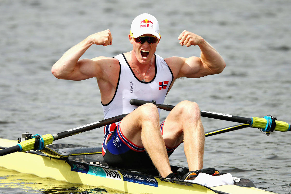 Norway's Kjetil Borch celebrates winning in rowing final of the Men's Single Sculls event at Strathclyde Country Park in Glasgow on August 5