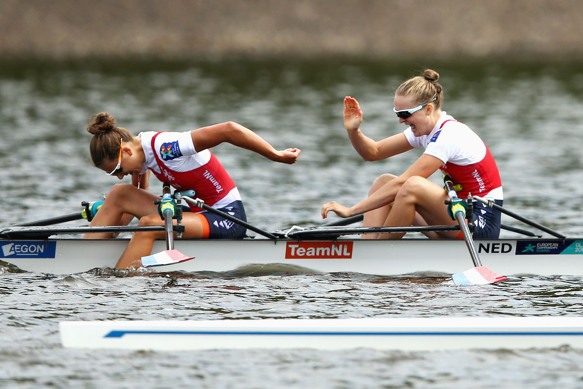Marieke Keijser and Ilse Paulis of Netherlands celebrate winning in the rowing final of the Lightweight Women's Double Sculls event at Strathclyde Country Park in Glasgow on August 5