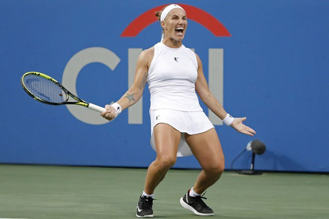 Russia's Svetlana Kuznetsova celebrates match point to beat Croatia's Donna Vekic and win the women's singles final in the Citi Open at Rock Creek Park Tennis Center in Washington on Sunday