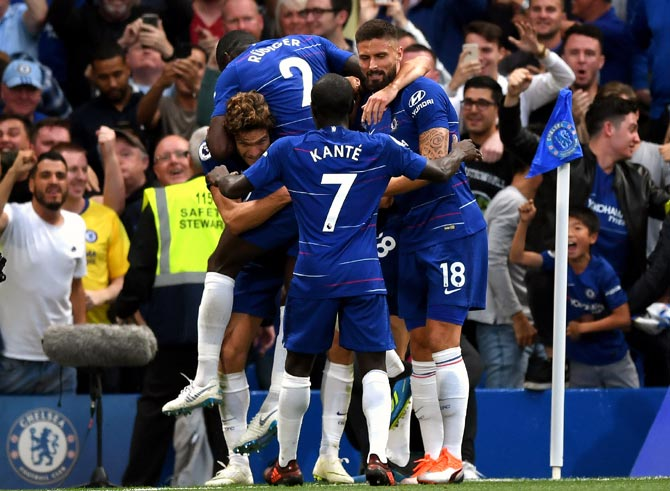 PHOTOS: Chelsea edge past Arsenal; Spurs down Fulham