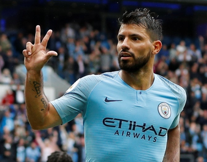 Rediff Sports - Cricket, Indian hockey, Tennis, Football, Chess, Golf - EPL PIX: City rout Huddersfield; Deeney inspires Watford