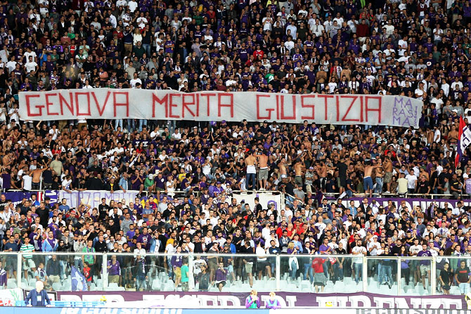 Rediff Sports - Cricket, Indian hockey, Tennis, Football, Chess, Golf - Football Briefs: Genoa fans stay silent to honour victims of collapse