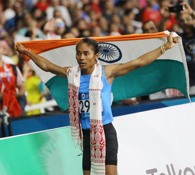 Hima Das celebrates after winning the silver at the Asian Games on Sunday