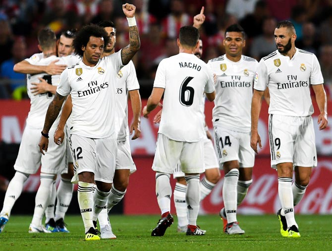 Rediff Sports - Cricket, Indian hockey, Tennis, Football, Chess, Golf - PIX: Real Madrid maintain perfect start with Benzema's double
