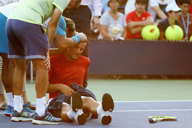 Rediff Sports - Cricket, Indian hockey, Tennis, Football, Chess, Golf - US Open: Players retire, fans collapse while heat rule in play at NYC