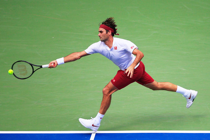 Rediff Sports - Cricket, Indian hockey, Tennis, Football, Chess, Golf - US Open PIX: Federer, Djokovic advance; Wozniacki crashes out