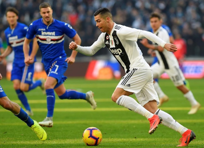 Rediff Sports - Cricket, Indian hockey, Tennis, Football, Chess, Golf - Ronaldo brace gives Juve contentious win