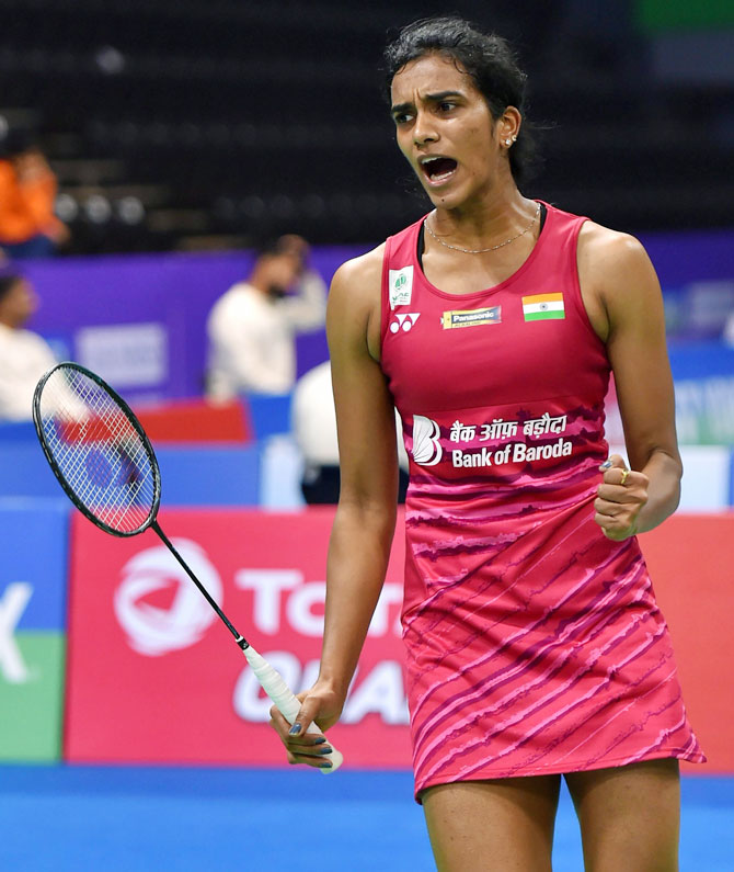 India badminton player PV Sindhu celebrates a point against Spanish shuttler Beatriz Corrales during their women's singles quarter-final of the India Open at Siri Fort Indoor Stadium in New Delhi on Friday
