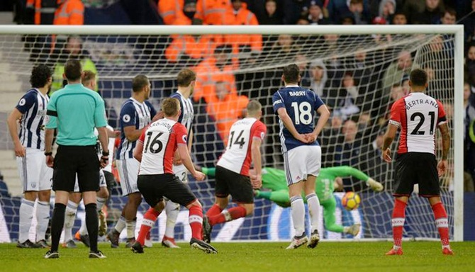 James Ward-Prowse (No. 16) scores Southampton's third goal from a free-kick