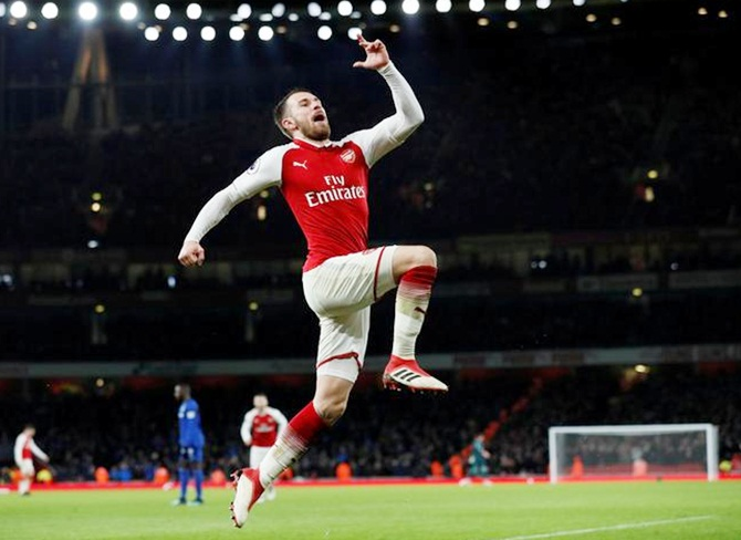 EPL PICS: Ramsey 'tricks' as Arsenal thrash Everton