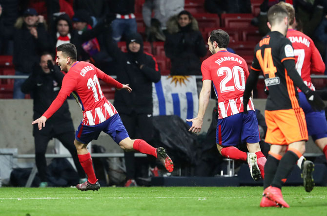 Atletico Madrid's Angel Correa celebrates scoring their first goal against Valencia at the Wanda Metropolitano in Madrid, Spain, on Sunday