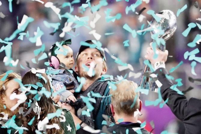 Nick Foles #9 of the Philadelphia Eagles celebrates with his daughter Lily Foles after his tean's 41-33 victory over the New England Patriots in Super Bowl LII final at US Bank Stadium in Minneapolis, Minnesota on Sunday