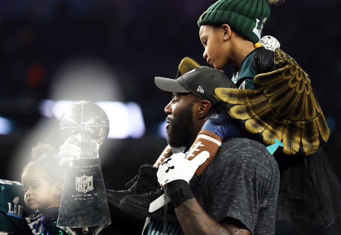 Malcolm Jenkins #27 of the Philadelphia Eagles kisses the Vince Lombardi Trophy