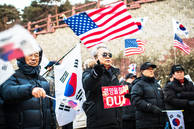 Anti-North Korea protesters demonstrate against a performance by North Korea's Samjiyon art troupe at Gangneung Art Centre in Gangneung, South Korea on Thursday