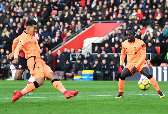 Liverpool's Roberto Firmino scores his side's first goal against Southampton at St Mary's Stadium in Southampton