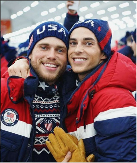 Gus Kensworthy and US figure skater Adam Rippon pose for a picture at the Winter Games opening ceremony on Friday