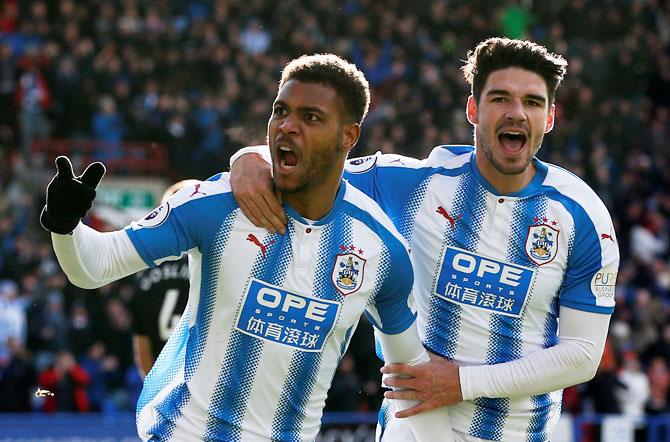 Huddersfield Town's Steve Mounie celebrates scoring their second goal with Christopher Schindler during their match against AFC Bournemouth at John Smith's Stadium in Huddersfield