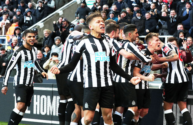 Newcastle United's Matt Ritchie celebrates with teammates after scoring against Manchester United at St James' Park in Newcastle on Sunday