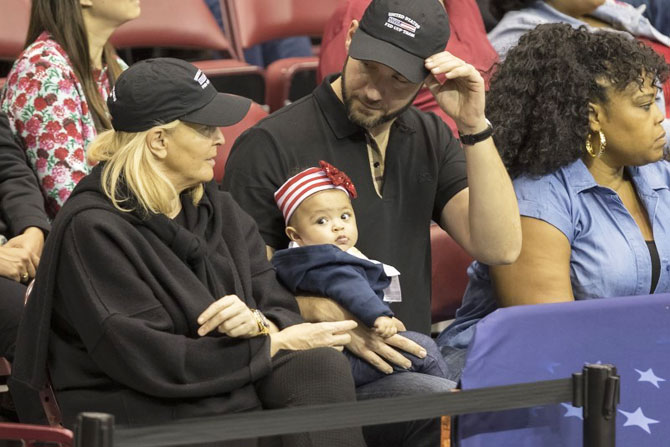 Serena Williams's husband Aleixis Ohanian (right) with their daughter Alexis Olympia Ohanian Jr at the Fed Cup match on Sunday