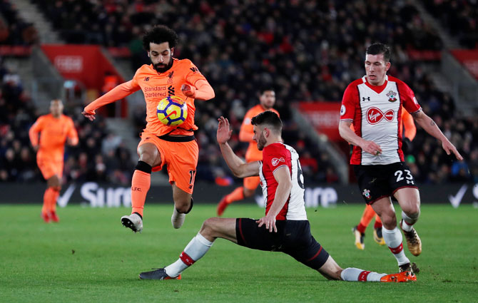 Liverpool's Mohamed Salah in challenged by Southampton's Wesley Hoedt