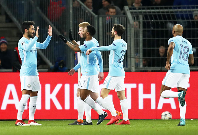 Manchester City's Ilkay Gundogan (left) celebrates with teammates after scoring a goal against FC Basel at St. Jakob-Park in Basel, Switzerland, on Tuesday