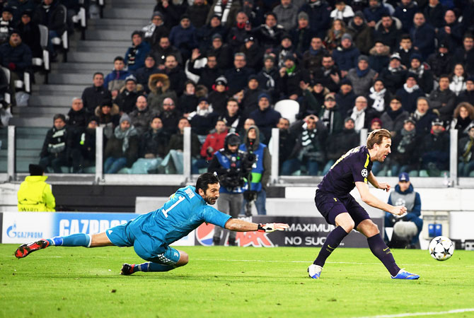 Tottenham Hotspur's Harry Kane scores his side's first goal past Juventus 'keeper Gianluigi Buffon at Allianz Stadium in Turin, Italy, on Tuesday