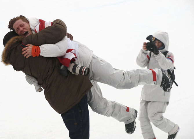 US snowboarding gold medallist Shaun White hugs a friend after the scores of the men's halfpipe finals are announced at the Phoenix Snow Park in Pyeongchang, South Korea, on Wednesday