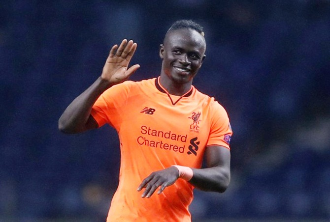 Liverpool's hat-trick hero Sadio Mane celebrates at the end of the Champions League last 16 first leg tie against Porto