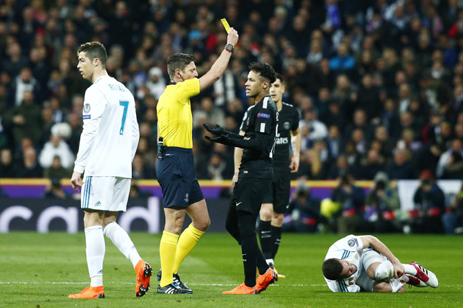 PSG's Neymar is shown a yellow card during their UEFA Champions League match against Real Madrid on Wednesday