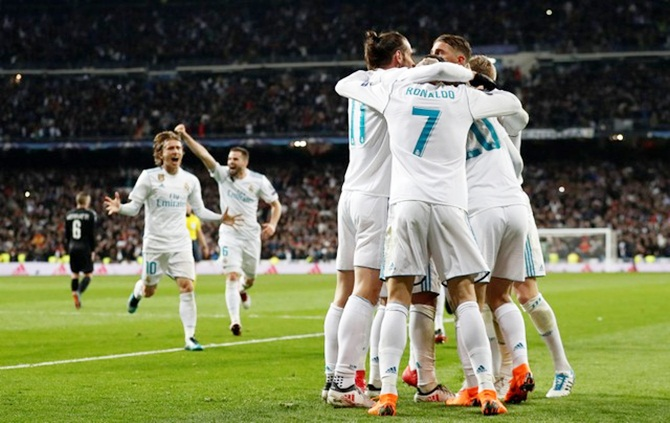 Marcelo is congratulated by his Real Madrid teammates after scoring