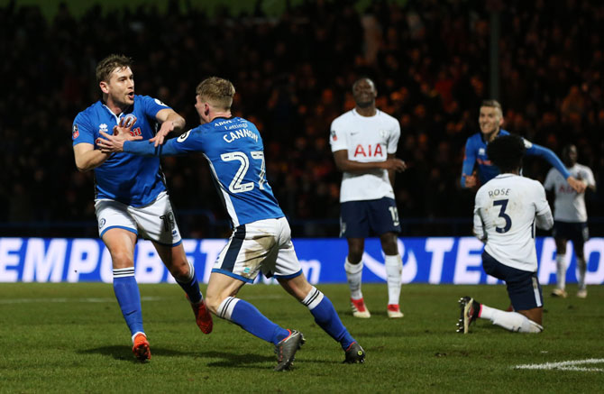 Rochdale AFC's Steve Davies celebrates scoring the equaliser with teammate Andrew Cannon during The Emirates FA Cup fifth round match against Tottenham Hotspur in Rochdale on Sunday
