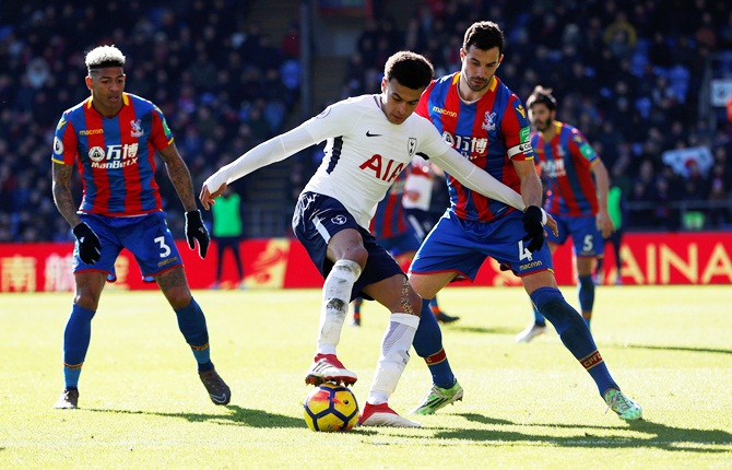 Tottenham's Dele Alli is challenged by Crystal Palace's Luka Milivojevic and Patrick van Aanholt