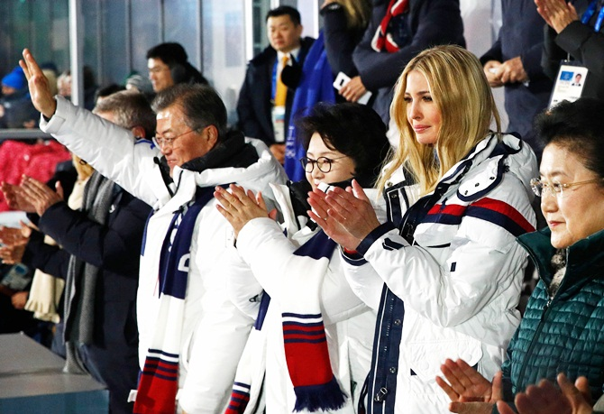 US President Donald Trump's daughter and senior White House adviser, Ivanka Trump, South Korean first lady Kim Jung-sook and South Korean President Moon Jae-in applaud during the closing ceremony