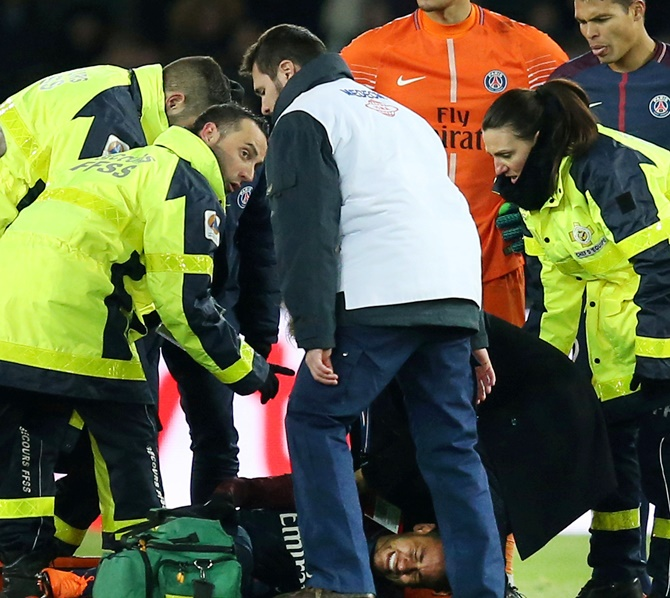 Paris Saint-Germain's Neymar is put onto a stretcher by medical staff after sustaining an injury on Sunday