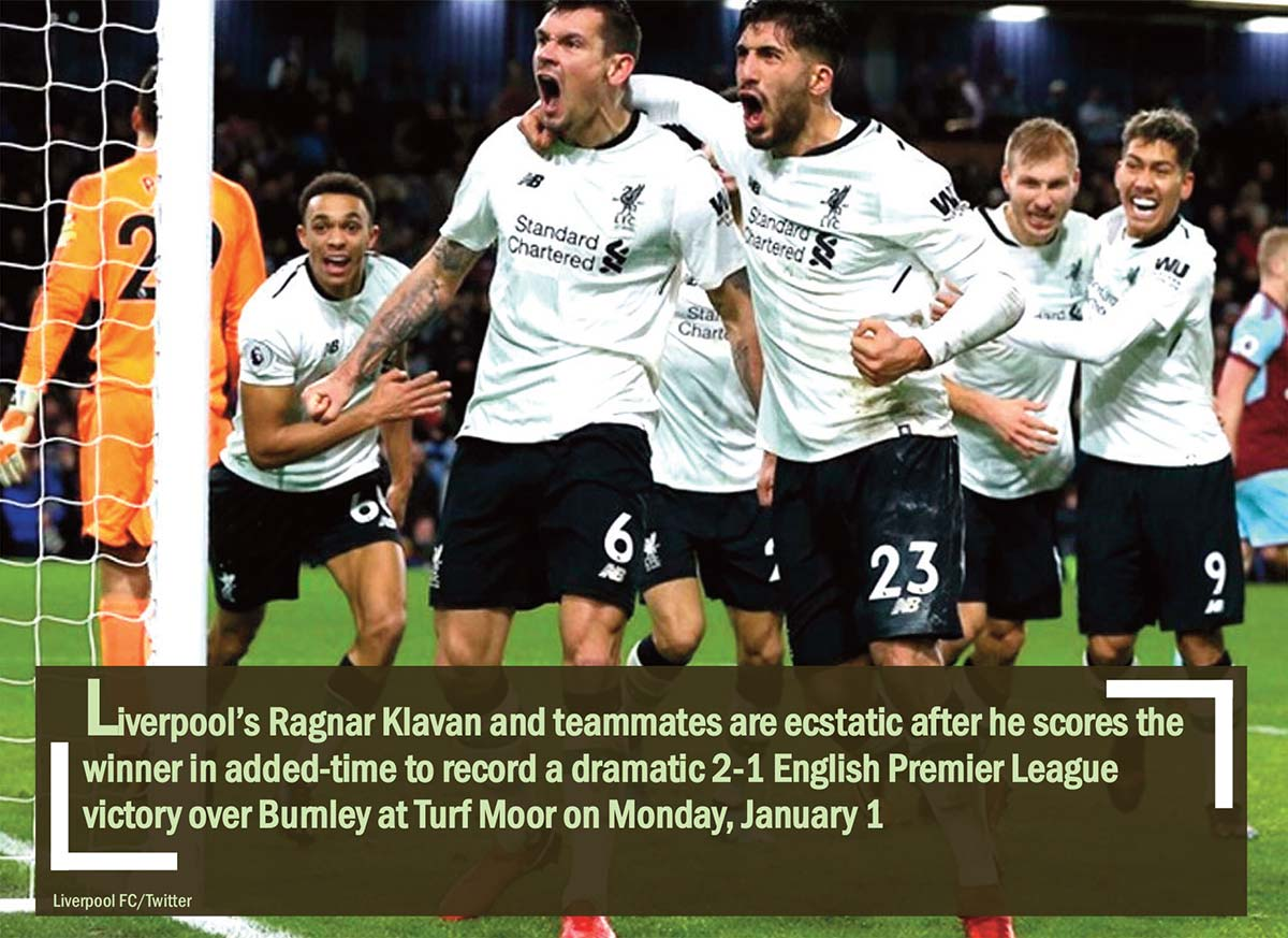 Liverpool's Ragnar Klavan and teammates are ecstatic after he scores the winner in added-time to record a dramatic 2-1 English Premier League victory over Burnley at Turf Moor on Monday, January 1