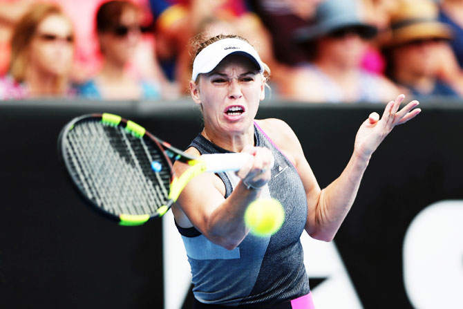 Denmark's Caroline Wozniacki plays a forehand in her match against Croatia's Petra Martic on Day 3 of the ASB Women's Classic at ASB Tennis Centre in Auckland, New Zealand, on Wednesday