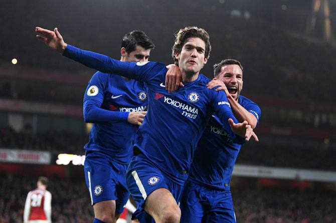 Chelsea's Marcos Alonso celebrates with teammate Danny Drinkwater after scoring his side's second goal