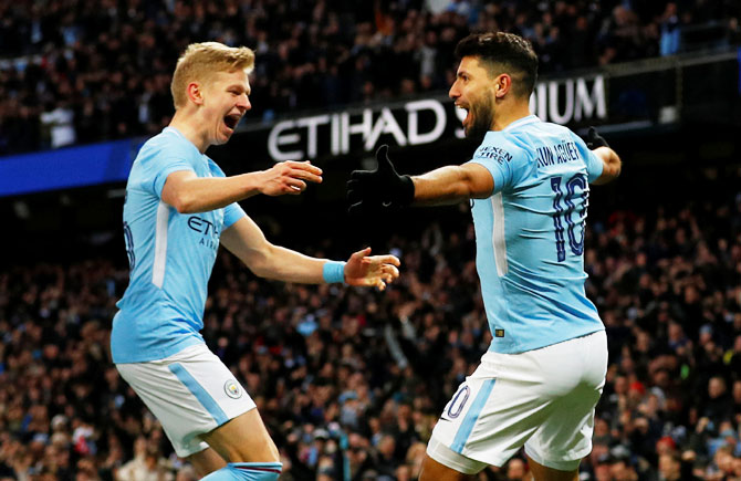 Manchester City's Sergio Aguero celebrates with Oleksandr Zinchenko after scoring their second goal against Burnley at Etihad Stadium in Manchester on Saturday